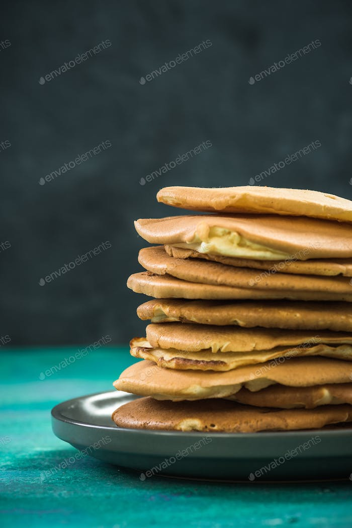 Pile of homemade pancakes on plate. Copy space.