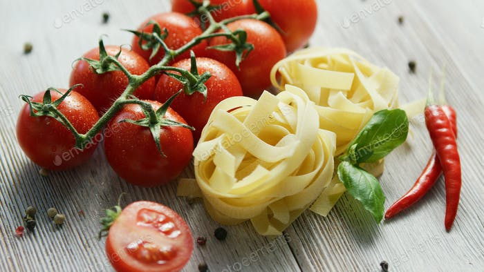 Uncooked pasta bunches with tomatoes