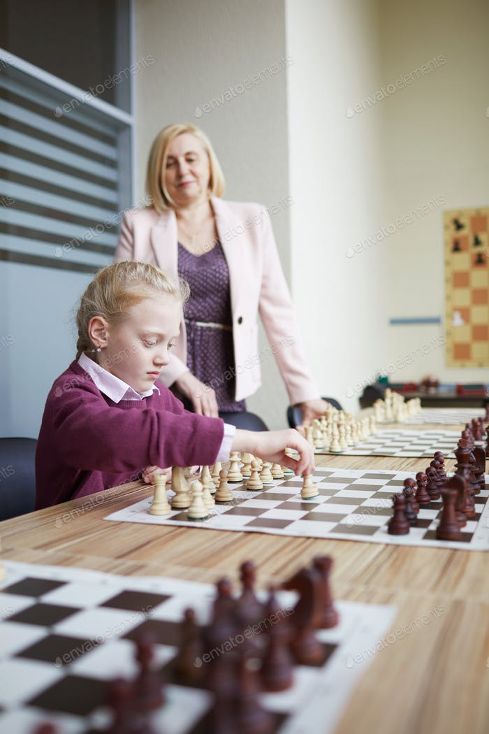 Teacher helping with chess