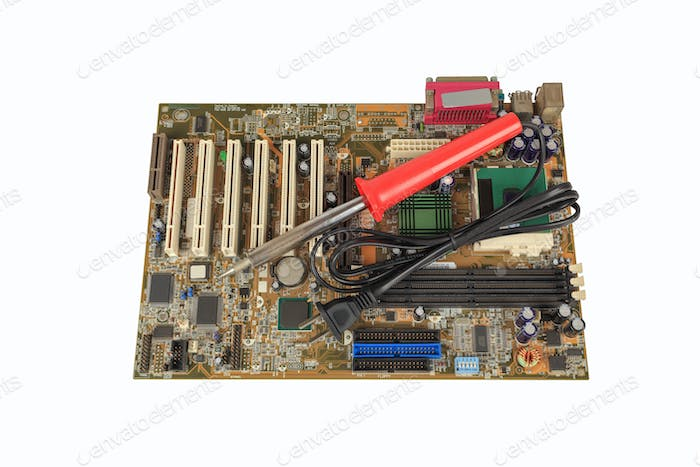 soldering iron on computer motherboard