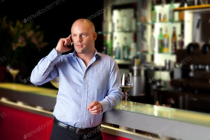young man talking to mobile phone