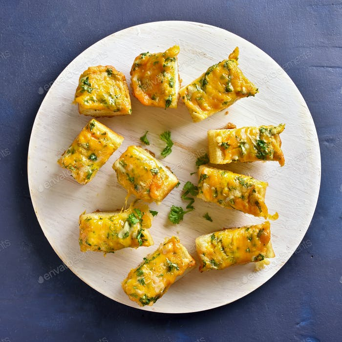 Cheese and garlic bread with greens