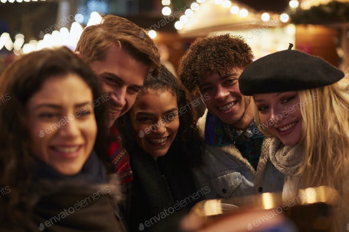 Young Friends Posing For Selfie At Christmas Market