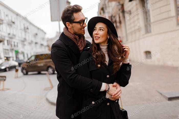Romantic moments of  beautiful elegant couple in love walking in the city.