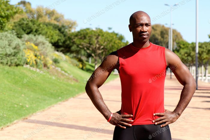 Fit young african sports man standing at the park
