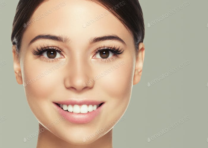 Eyes lashes woman face close up natural make up healthy skin. Color background.