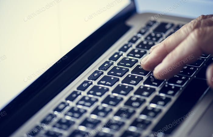 Hand working typing on laptop