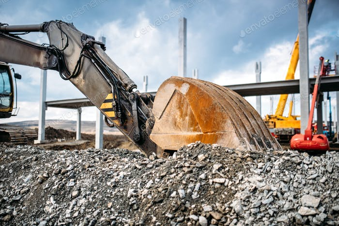 Close up details of heavy machinery excavator. Industrial scoop of excavator working on site