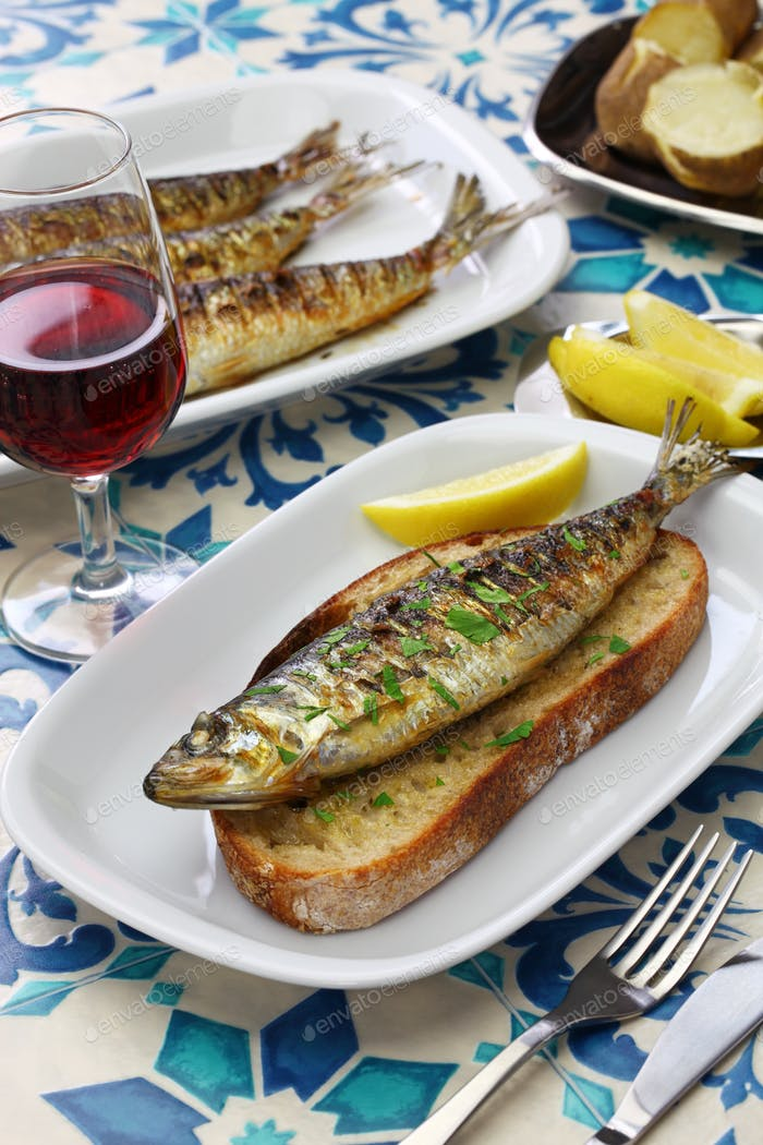 portuguese grilled sardine on toasted bread