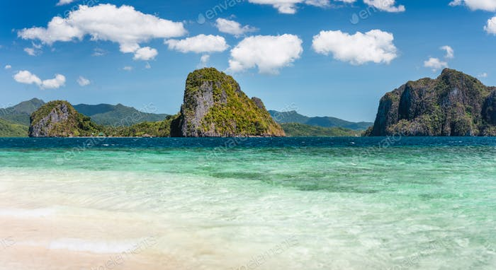 El Nido, Philippines. Panorama of limestone islands in El Nido Lagoon. Private Malapacao island in