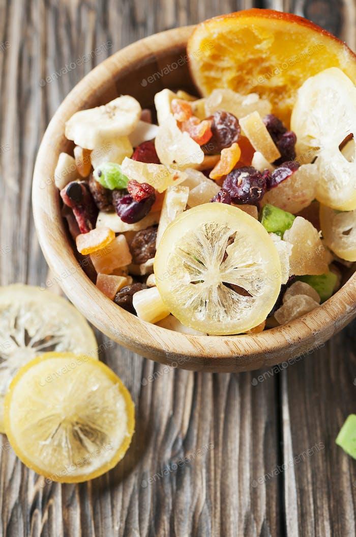 Homemade succade: lemon, orange, kiwi, banana, mango on the wooden table