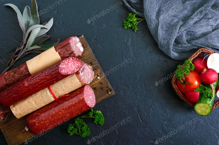 Several kinds of sausage, fresh vegetables and greens