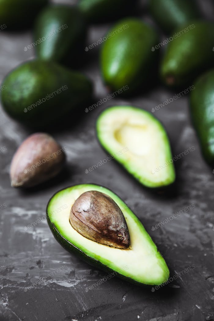 Fresh avocado on dark background. Vegetarian food concept. Top view