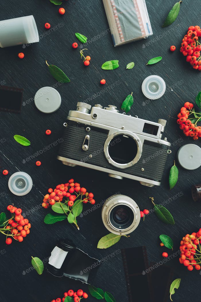 Vintage retro film camera flat lay