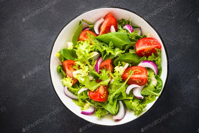 Green salad from leaves and tomatoes