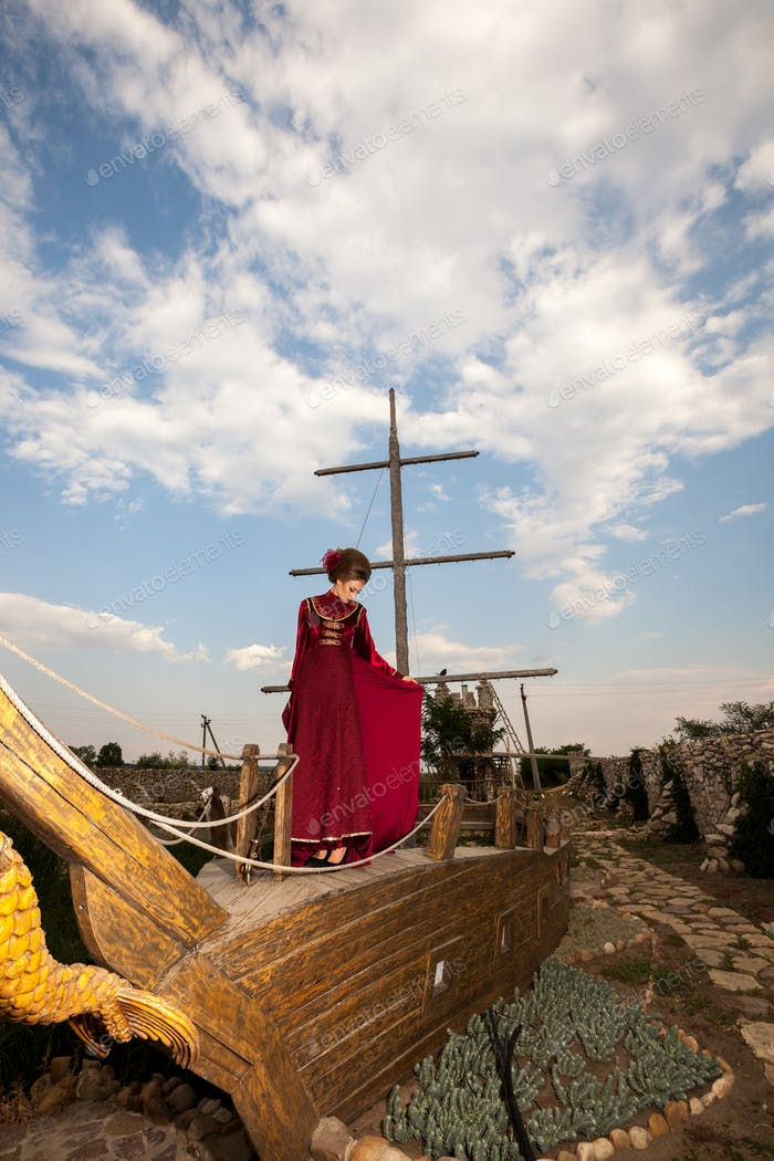 Woman in vintage clothes on a boat