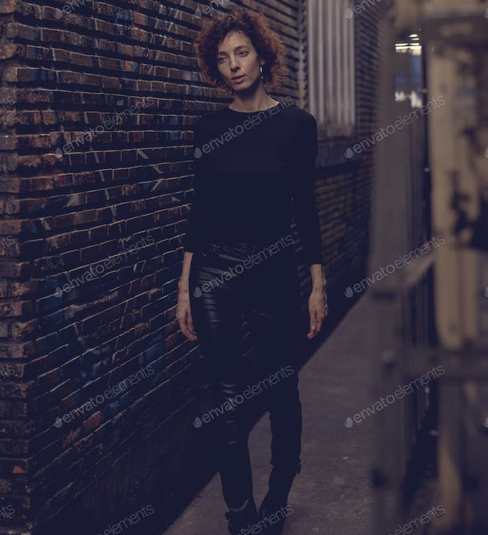 Woman walking through an alley