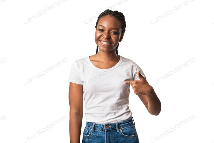 Cheerful Black Woman Pointing Finger At Herself On White Background