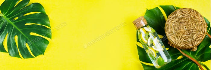 Summer Banner for website. Round rattan bag and glass bottle with lemonade and Monstera leaf