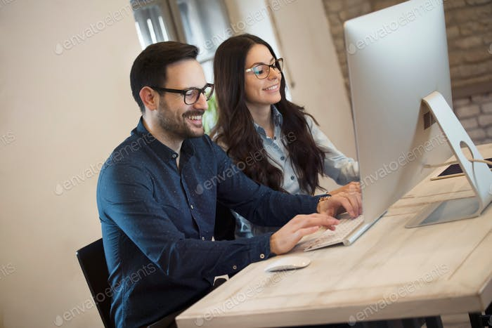 Portrait of young designers working on computer