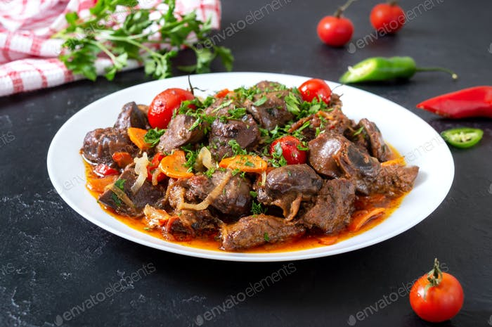 Roast offal with vegetables. Armenian dish Kuchmachi.
