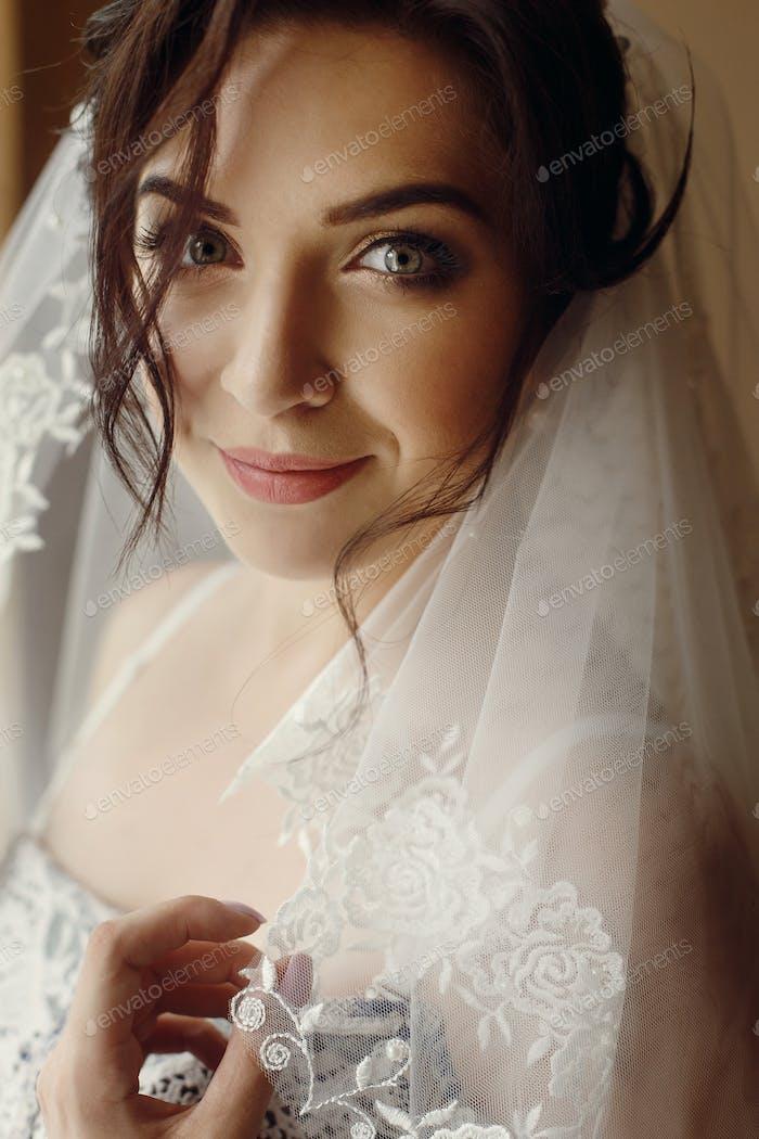 gorgeous beautiful bride portrait in morning near window soft light