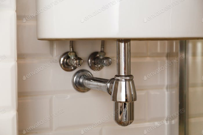 Basin siphon or sink drain in a bathroom, clean