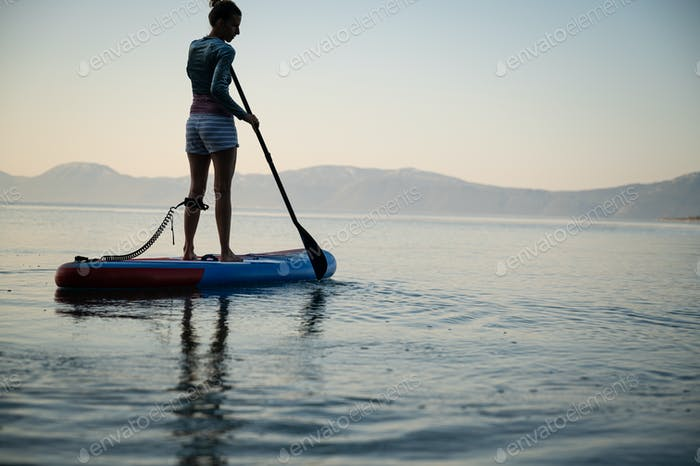 Young woman on sup board