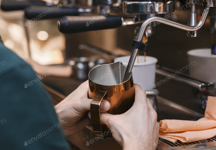 Male Hands Making Coffee Drink Using Coffee-Machine In Cafeteria