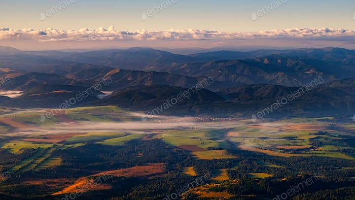 Panoramic colorful landscape of fields, meadows and mountains, High Tatras, Slovakia