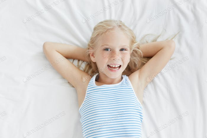 Children, happiness and body language concept. Beautiful blonde female child with delightful express