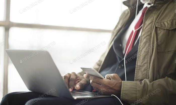 Businessman Using Laptop Mobile Sitting Concept