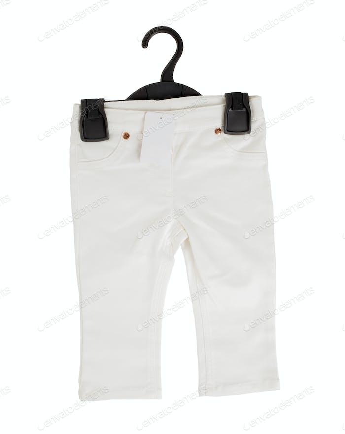 White denim shorts on black plastic hanger.