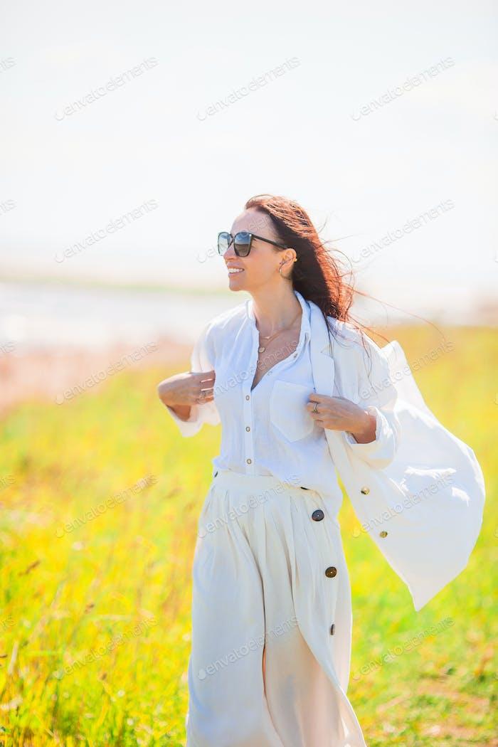 Adorable woman at beach during summer vacation