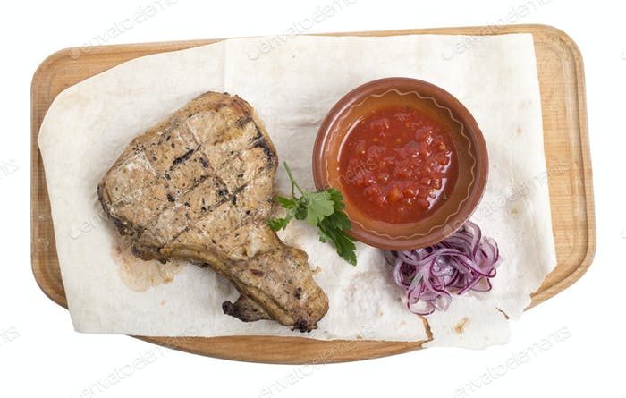 Chicken steak with tomato sauce.