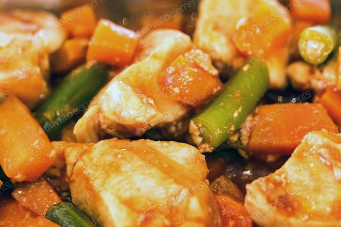 Braised chicken with vegetables close up background