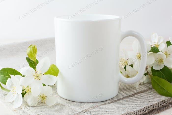White coffee mug mockup with apple blossom