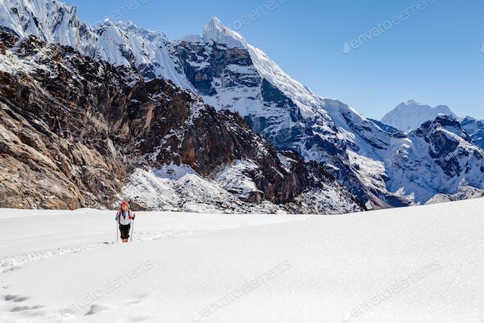 Hiking Woman Crossing Cho La Pass in Himalaya Mountain s, Nepal