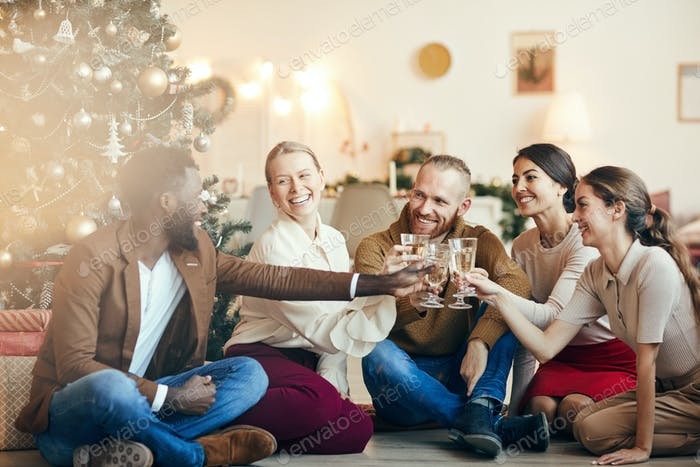 Friends Celebrating by Christmas Tree