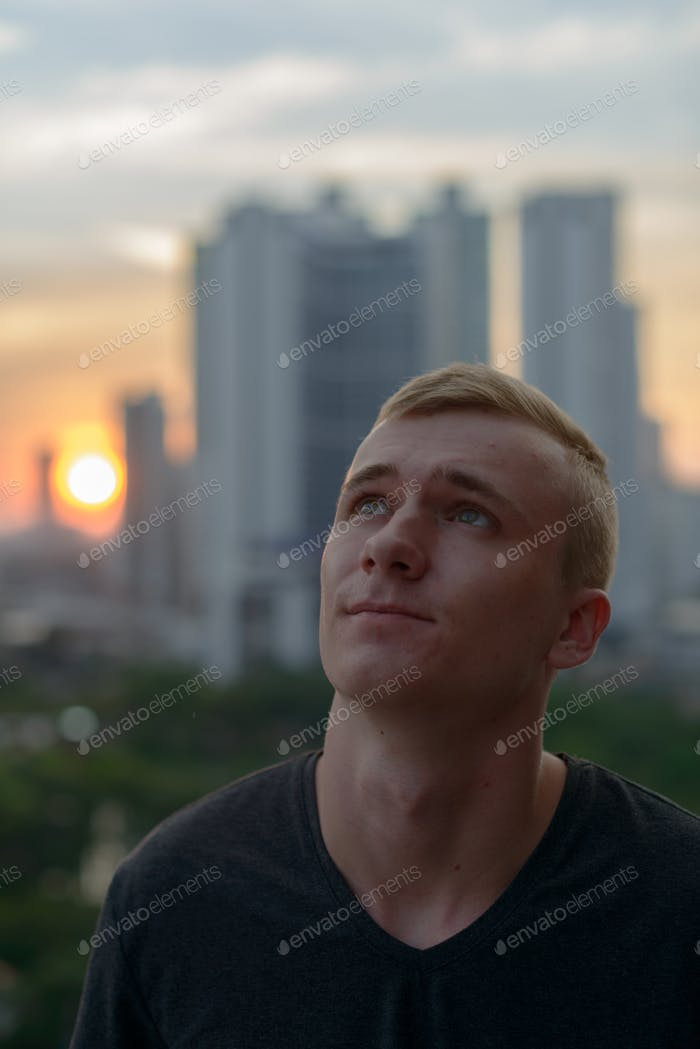 Portrait of young blond man outdoors