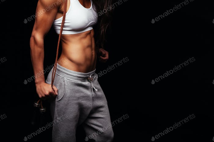 Fit young woman with skipping ropes