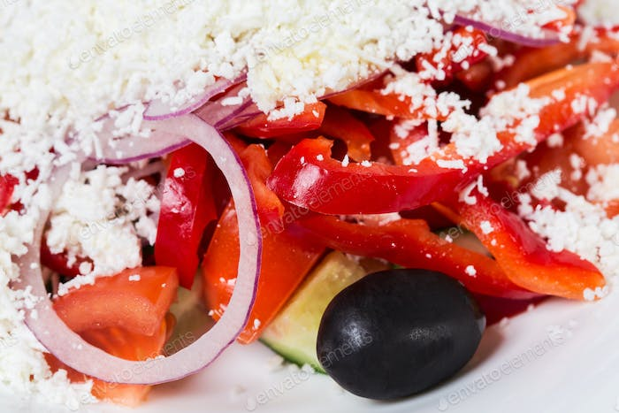 Fresh vegetable salad with grated cheese.