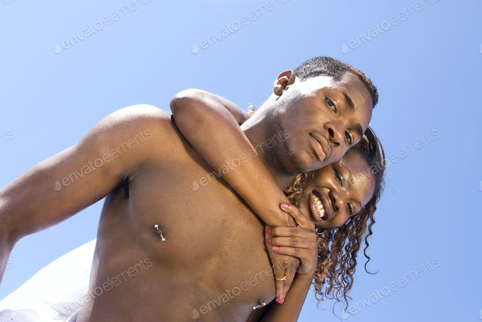 African American couple embracing at the beach