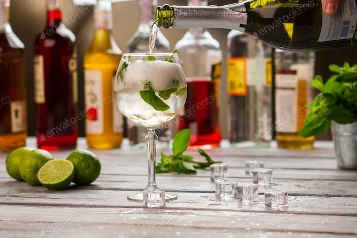 Bottle pours liquid into glass