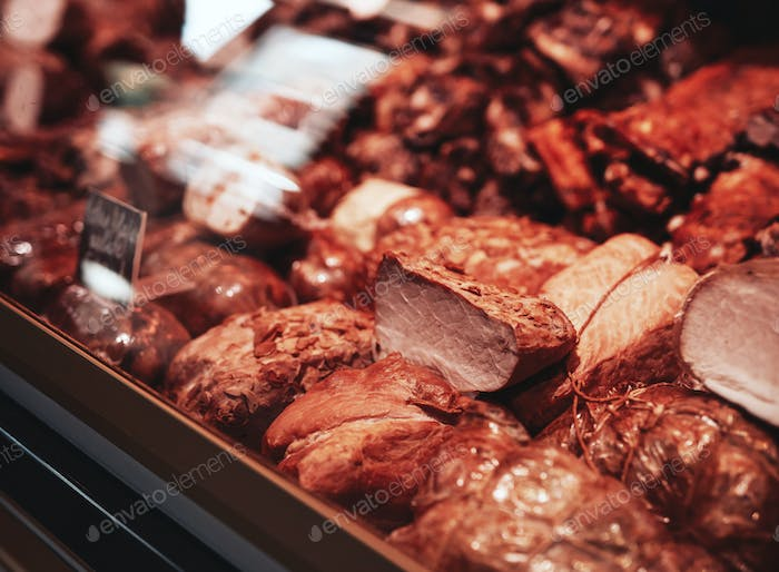 Close up of smoked meat in butcher shop