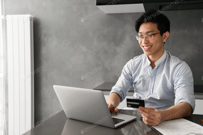 Portrait of a smiling young asian man