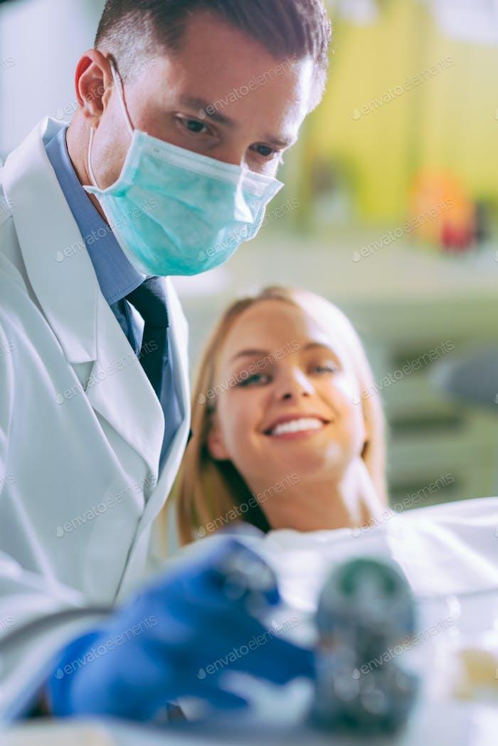 Dentist drilling teeth