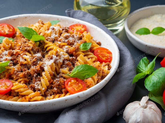 Bolognese pasta. Fusilli with tomato sauce, ground minced beef