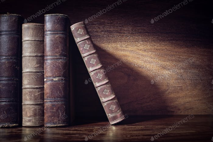 Old books on a library shelf background