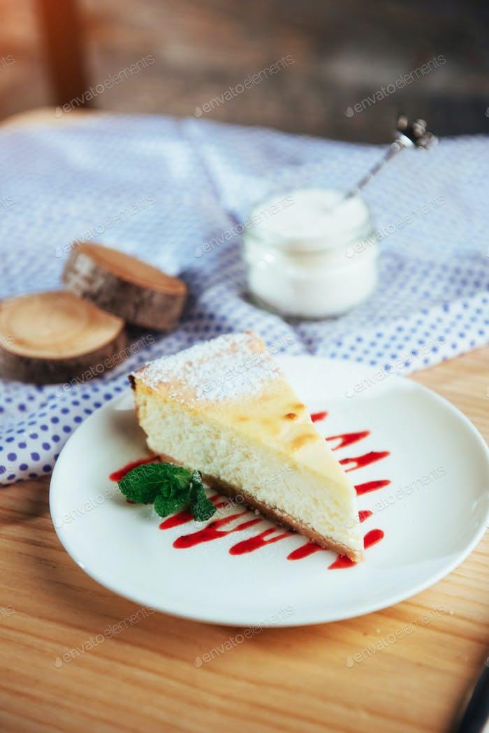 triangle cheese cakes in cafe. On a wooden table